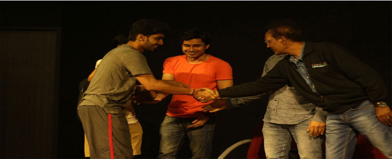 Our-student-receiving-best-actor-award
